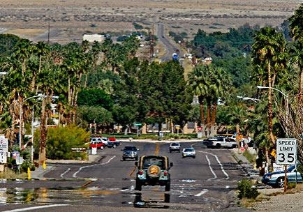 Palm Canyon Drive descends through a mirage to the park at Christmas Circle, the center of Borrego Springs.   (Don Bartletti / Los Angeles Times)